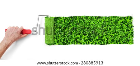 Painting the wall with grass - stock photo