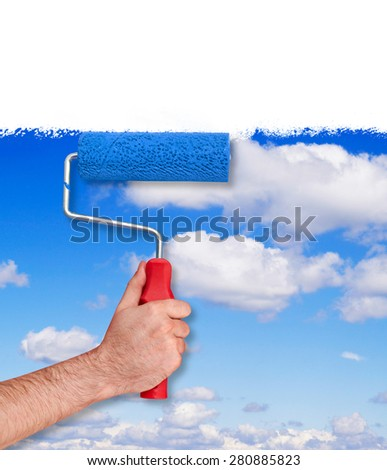 Painting the wall with sky texture - stock photo