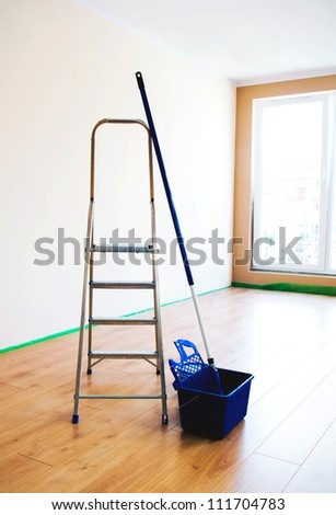 Painting tools in empty room - stock photo