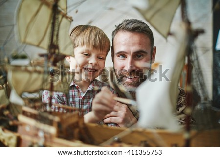 Painting toy ship - stock photo