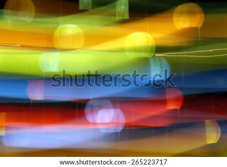 Painting with light forms abstract blurs in the colors of the rainbow  - stock photo