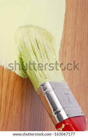 painting wood surface - stock photo