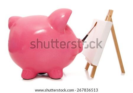 painting your future piggy bank cutout - stock photo