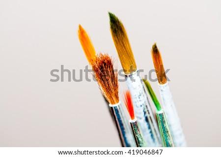 Paints and brushes isolated on white background - stock photo