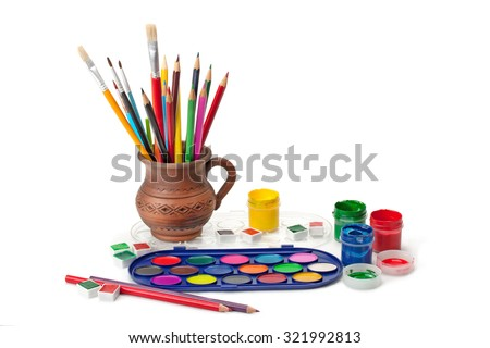 paints, gouache , brush , colored pencils in a clay jug isolated on white background - stock photo