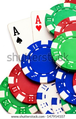 Pair of aces and poker chips isolated on black background  - stock photo