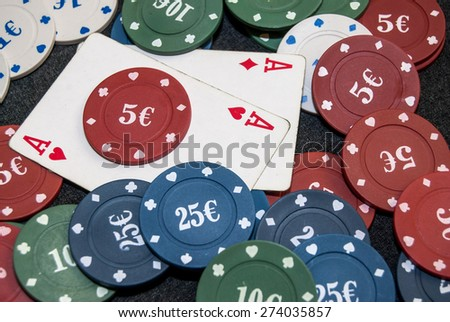 pair of aces with chips for poker - stock photo