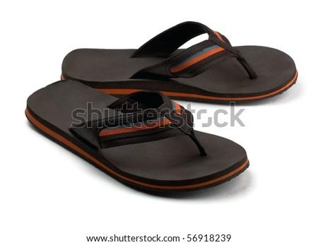 Pair of black mens flip flops isolated on white - stock photo