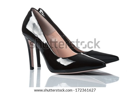 pair of black varnished leather female high heel shoes. isolated on white - stock photo
