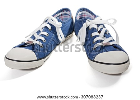 Pair of blue canvas sneakers isolated on white background - stock photo