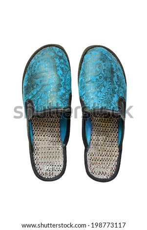 Pair of blue home slippers on white background - stock photo