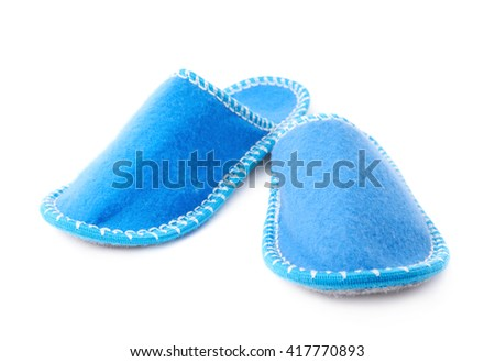 Pair of blue house slippers isolated over white background - stock photo