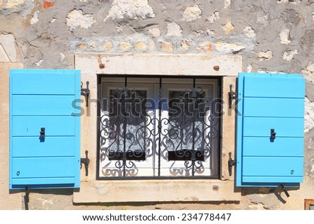 Pair of blue shutters of a window on stone wall, Rovinj, Croatia - stock photo