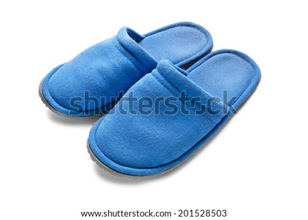 Pair of blue textile slippers on white background closeup - stock photo