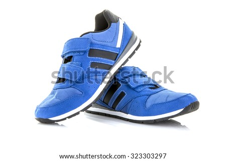 Pair Of Blue Training Shoes on a White Background - stock photo
