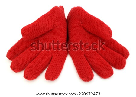 Pair of bright red woolen gloves on a white background - stock photo