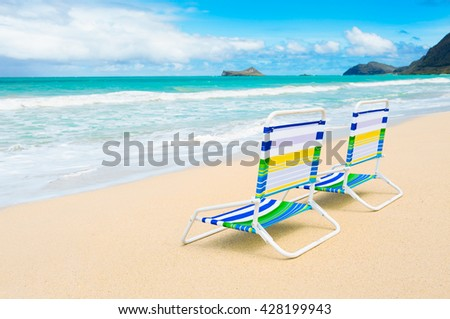 Pair of chairs on a beautiful beach in Hawaii. - stock photo