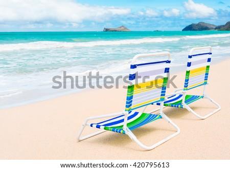 Pair of chairs on a beautiful beach. (location Hawaii) - stock photo