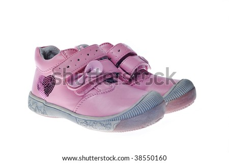 pair of child shoes on white - stock photo