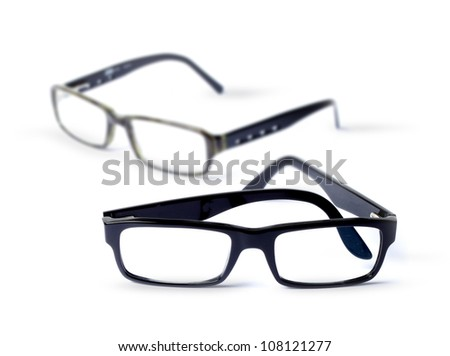 Pair of classic eye glasses, shallow DOF - stock photo