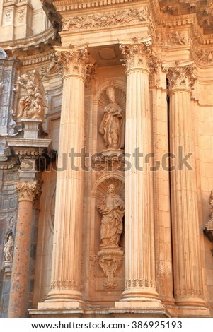 Pair of columns decorate the Baroque facade of the Cathedral Church of Saint Mary in Murcia, Spain - stock photo