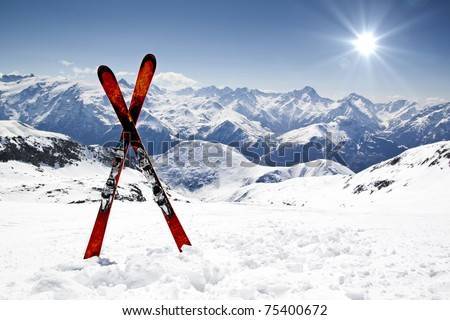 Pair of cross skis in snow - stock photo