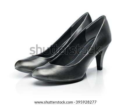 Pair of dark grey everyday pumps isolated on white with reflection. - stock photo