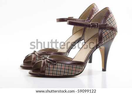 Pair of fabric high heel shoes - stock photo