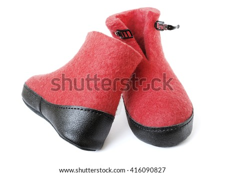 Pair of felt boots bright red color with an iron clasp - stock photo