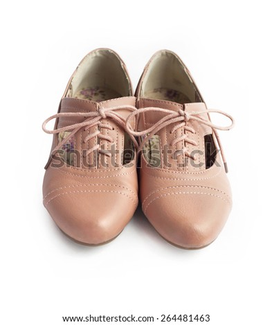Pair of female shoes on white background - stock photo