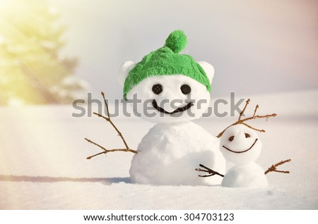 Pair of funny snowmen - stock photo