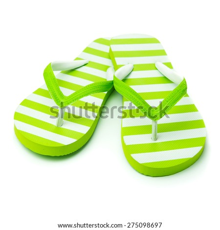 Pair of green striped sandal on white background - stock photo
