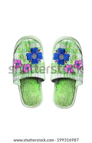 Pair of green textile home slippers on white background - stock photo