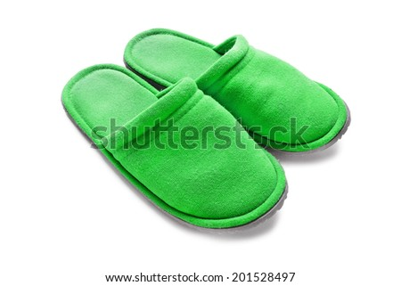 Pair of  green textile slippers isolated over white - stock photo