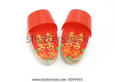 Pair of hand painted red Double Happiness clogs on white background - stock photo