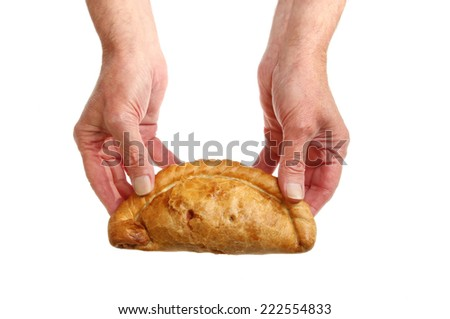 Pair of hands holding a Cornish pasty isolated against white - stock photo