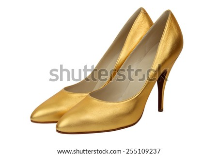 Pair of high heel gold women shoes isolated on white - stock photo