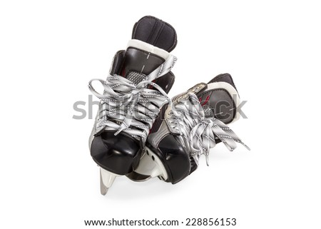 Pair of hockey skates black with gray laces isolated on white background - stock photo