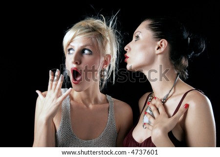 pair of ladies with reaction on their faces - stock photo