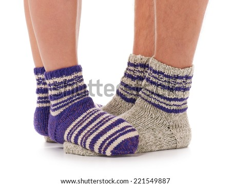 Pair of man and woman in the knitted socks over white background - stock photo