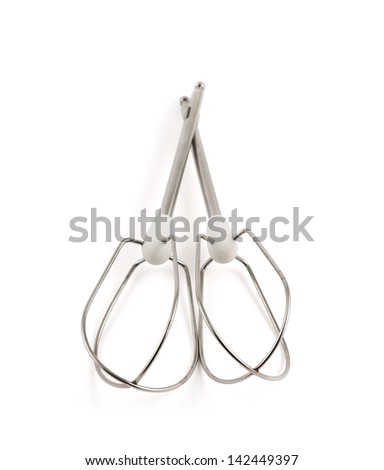 Pair of manual hand egg beater mixer composition, isolated over white background, shallow depth of field - stock photo
