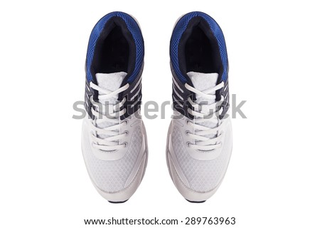 Pair of men's white sneakers on a white background, top view - stock photo