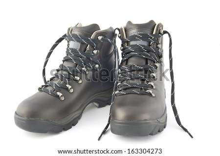 Pair of new black hiking boots isolated on white. - stock photo