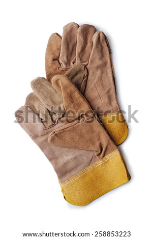 Pair of new natural brown leather gardening or workmans gloves lying overlapped on a white background, overhead view - stock photo