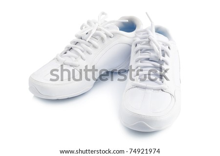 Pair of new sneaker on white background - stock photo