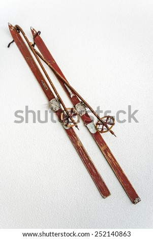 Pair of old wooden skis on white background - stock photo