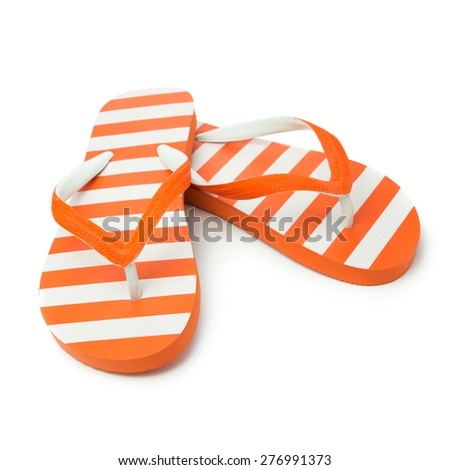 Pair of orange striped sandal on white background - stock photo