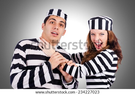 Pair of prisoners isolated on white - stock photo
