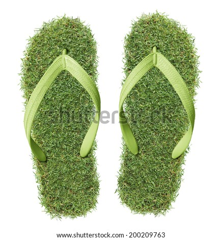 pair of real grass flip-flops isolated on white - stock photo