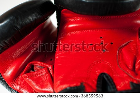 Pair of red and black leather boxing gloves. - stock photo